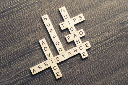Scrabble game spelling out support and assistance