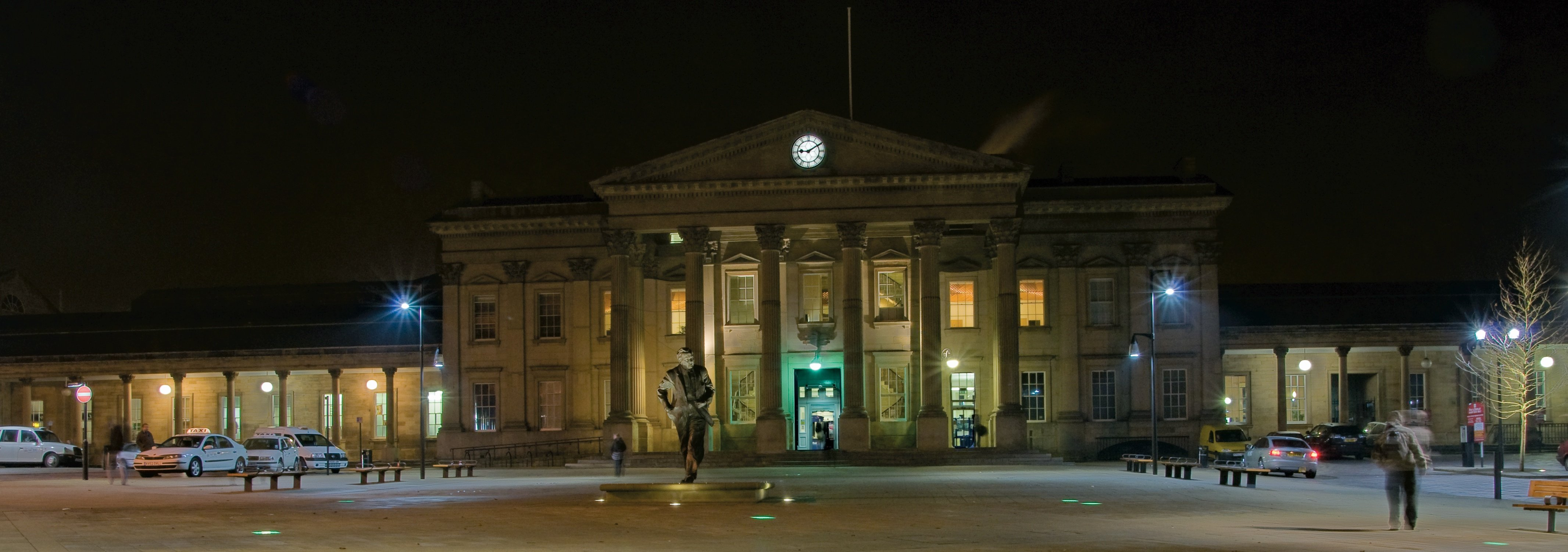Exterior of Huddersfield train station at nighttime