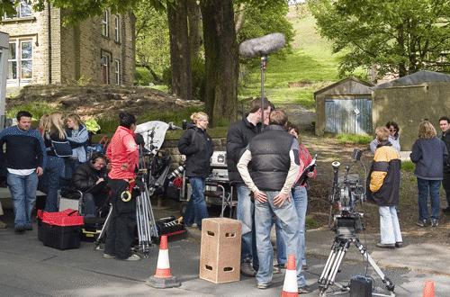 Television crew filming at a location in Huddersfield